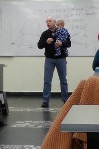 photo of professor holding student's baby